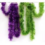 "Purple or Lime Green Tinsel Garland is shiny and measures 4"" x 9'. Put this around your tables, frame a door way or wear it for a funny picture!"
