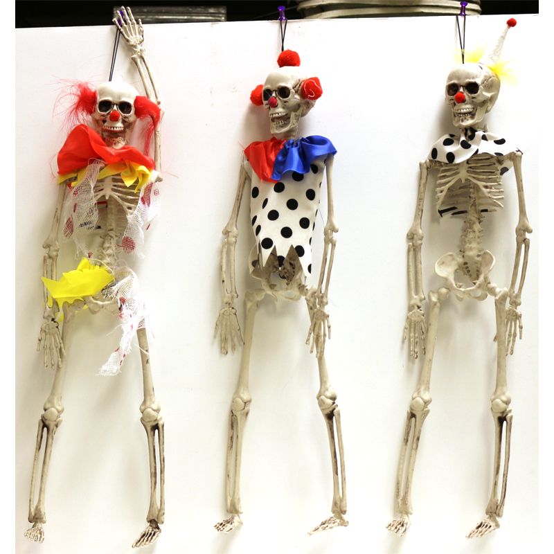 """Plastic Hanging Clown Skeleton come in 3 different styles. They are made of hard plastic. Jointed at the jaw, shoulders and hips and measure 16"""" x 3""""."""