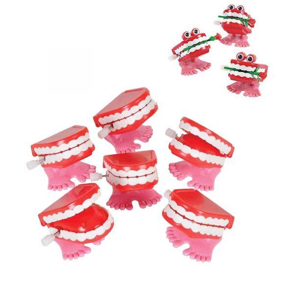Wind-up walking teeth or Chattering Teeth with long-stem rose